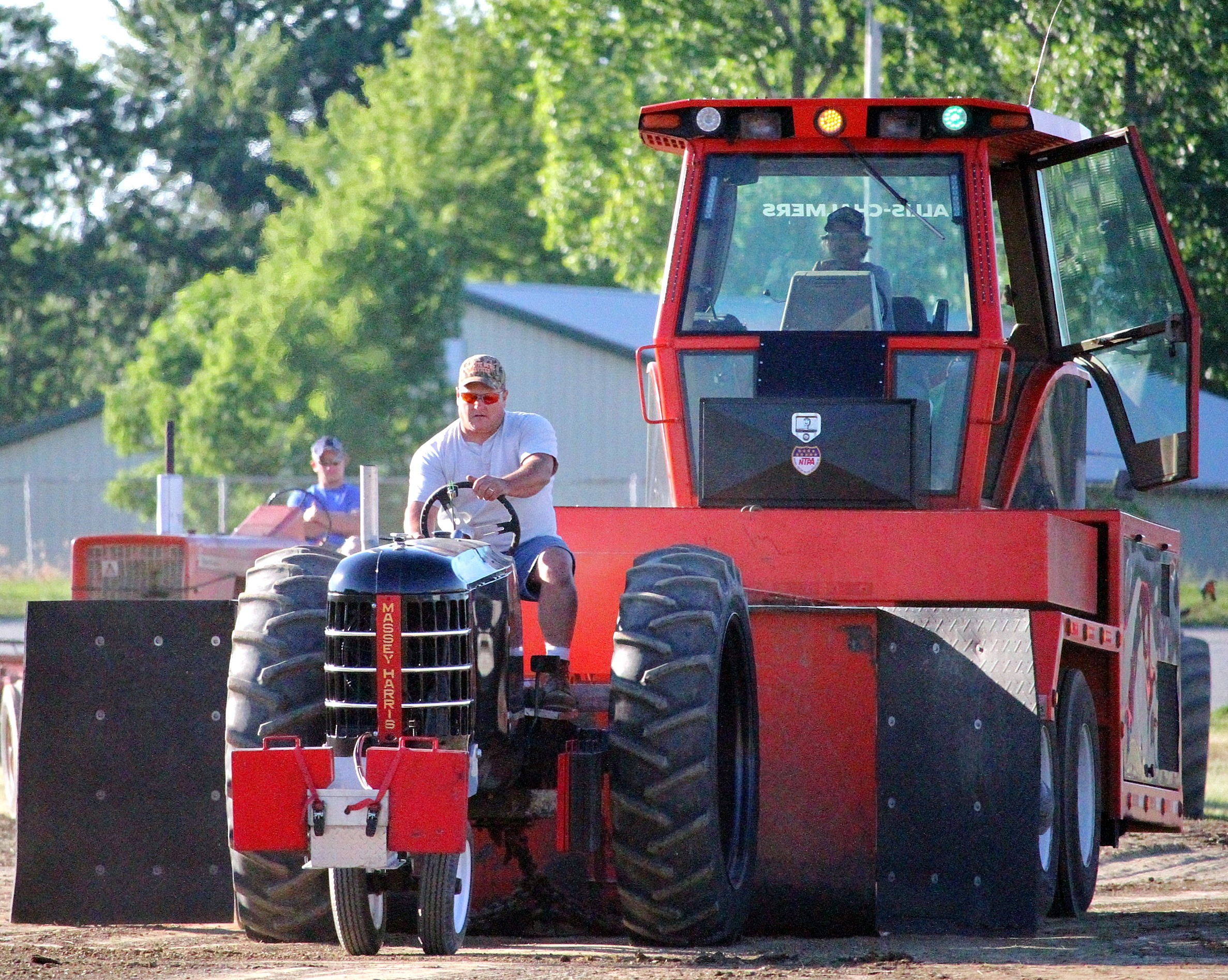 Crawford County NowBob StrohmBarry Flutypulls the sled, during Friday evening's antique tractor pull.
